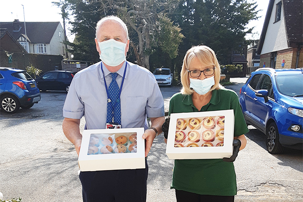 Woodstock Residential Care Home residents receive cakes from the Oasis School